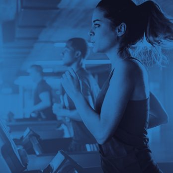 Image showing multiple members running on treadmills